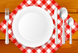 Wooden table, cloth, plate and stainless cutlery