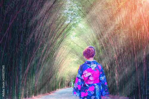 Fotobehang Bamboe Bamboo Forest. Asian woman wearing japanese traditional kimono at Bamboo Forest.