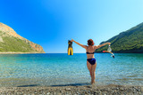 Woman with flippers snorkeling tube on beach - 209338926