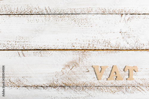 VAT term on white painted table