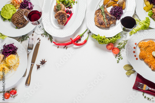 Different meat dishes with vegetables and spices. Top view. Flatlay. Copy space - 209344724