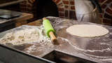 Dough with flour and rolling pin on table. Homemade pastry for bread or pizza. Bakery background - 209349378