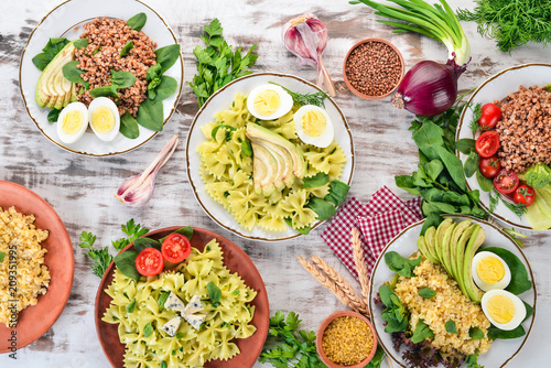 A set of food from buckwheat, bulgur and pasta. On a wooden background. Top view. Copy space.