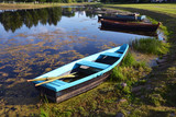 Old wooden boats in  park pond - 209356920