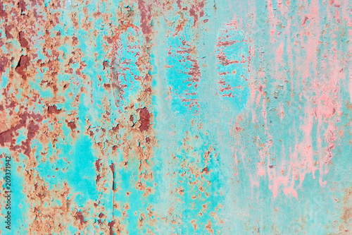 Texture turquoise rust pink streaks, the surface of the old fence corrosion
