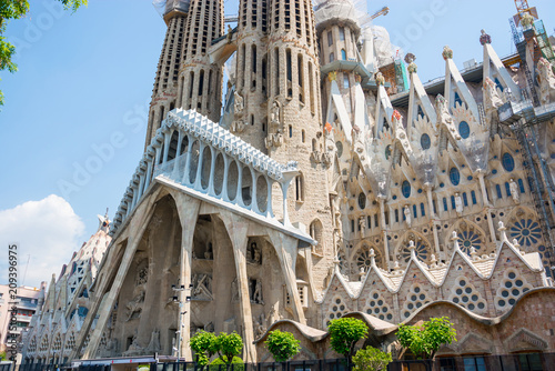 Part of the facade of Sagrada Familia in summer, Barcelona, Spain © allai