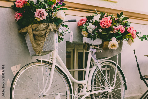 Fotobehang Fiets soft focus concept of vintage white cycle with flowers and