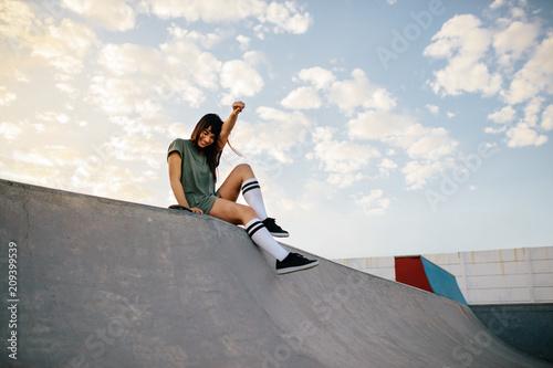 Fotobehang Skateboard Happy urban woman in skate-park having fun