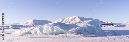 Svalbard - icebergs appearing through a frozen sea - Longyearbyen - the arctic circle - north pole tour expedition - 209401108