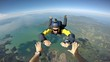 Leinwanddruck Bild - Skydiver point of view above the beach