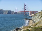 Golden Gate Bridge in San Francisco and Marshall's beach on a summer day