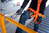 Construction worker use safety harness and safety line working on a new construction site project. - 209417593