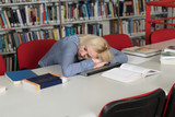 Tired Student Sleeping In Library - 209417716