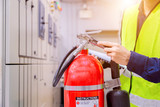 Engineer inspection Fire extinguisher in control room. - 209431343