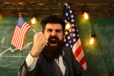 shouting businessman with american flag and raised hand.