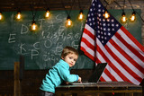 Patriotism and freedom. patriotism of small kid work on laptop with american flag. - 209437386