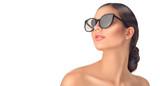 Beauty fashion model girl wearing sunglasses. Beautiful woman portrait over white background - 209439142
