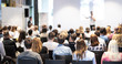 Leinwandbild Motiv Speaker giving a talk in conference hall at business event. Audience at the conference hall. Business and Entrepreneurship concept. Focus on unrecognizable people in audience.