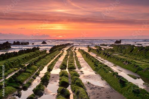 Aluminium Koraal amazing sunset landscape at rocky beach