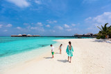 Mother and kids at tropical beach - 209449960