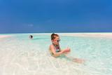 Kids having fun at beach - 209450181