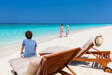 Mother and kids at tropical beach - 209450932