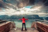 Tourist on Stegastein viewpoint, Norway - 209452189