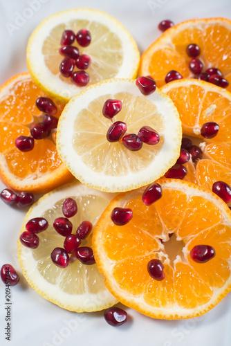Orange slices with garnet seeds on