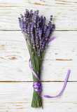 Bouquet of lavender on an old wooden table. Rustic style. Top view and copy space - 209460737