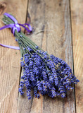 Bouquet of lavender on an old wooden table. Rustic style. Top view and copy space - 209460765