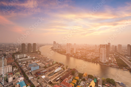 Fotobehang Bangkok Beautiful after sunset skyline over Bangkok city and river curved aerial view, Thailand