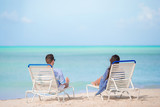 Couple relax on a tropical beach at Maldives - 209465541