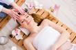 Leinwanddruck Bild - Young woman during spa procedure in salon