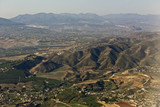 Inflight shot of the hills and towns between Malaga airport and the Montes de Malaga, Andalucia, Spain. - 209481558