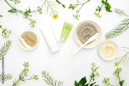 Leinwanddruck Bild Natural cosmetics set with various kinds of cosmetic clays and herbs