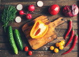 Ingredients for salad around cutting board. Fresh vegetables and herbs. Cooking. - 209491319