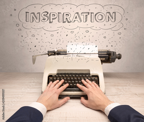 Fototapeta First person perspective hand writing on typewriter with cloud message concept