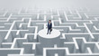 Businessman standing on the top a maze and looking through