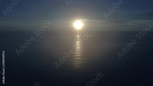 Aerial drone video clip of sunset over ocean