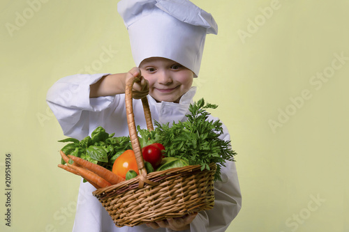 funny boy chef chef holding a basket of vegetables