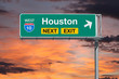 Houston Texas Route 10 Freeway Next Exit Sign with Sunset Sky