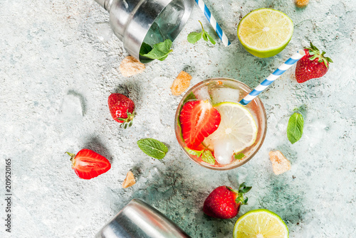 Summer refreshment drink, strawberry mojito cocktail on light concrete background, copy space - 209520165