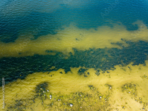 Fotobehang Meloen drone image. aerial view of Baltic sea shore with rocks and forest on land