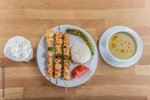 Grilled chicken on bamboo skewers. Chicken kebab on plate, close up view. - 209523791