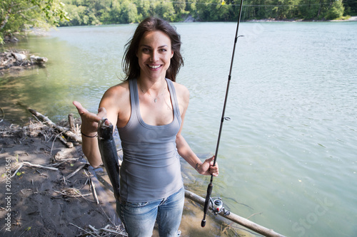 Fishing woman with fresh caught trout
