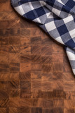 Top  of view checkered tablecloth on empty wooden butcher board - 209527778