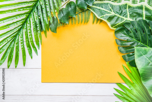 flat lay background with tropical leaves and copy space top view