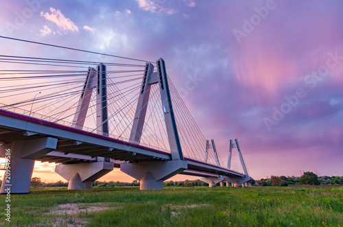 Foto Murales Cable stayed bridge over Vistula river, Krakow, Poland, beautiful colorful sunset