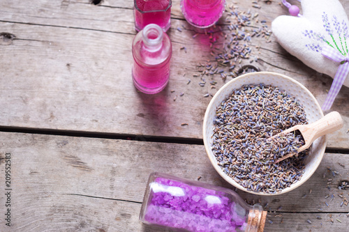 Dry lavender buds bowl, sachet wit lavender  and bottles with cosmetics