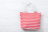 Summer accessories hat and bag on white wooden background. - 209570391
